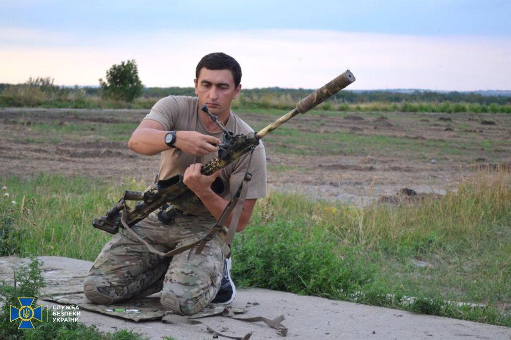 Ликвидированный ополченцами снайпер полковник СБУ Денис Волочаев